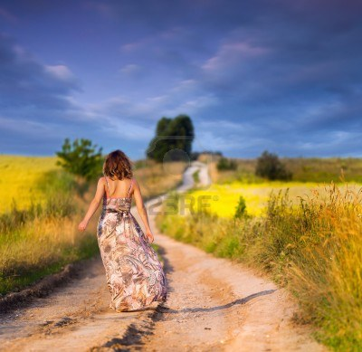 beautiful-white-girl-walking-the-road-before-sunset